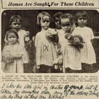 A black and white news clipping of six children from the Kahlin Compound. A handwritten note reads: I like the little girl in the centre of group, but if taken by anyone else, any of others too will do, as long as they are strong.
