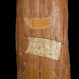 A bark slab is painted with an image of a ship and a canoe in a traditional Indigenous art style.