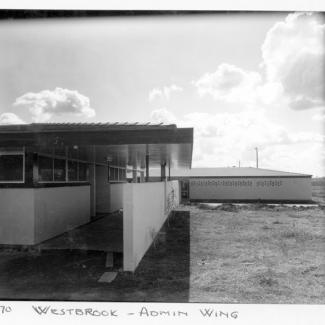 "A black and white photograph of buildings at Westbrook Training Centre. On the photograph is written: ""May seventy, Westbrook, Admin Wing""."